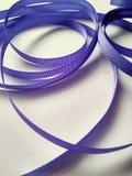 Blue ribbon close up on white background stock image