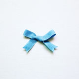 Blue ribbon on white background. Top view Royalty Free Stock Photo