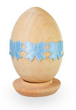 Blue ribbon on wooden egg Royalty Free Stock Images