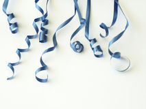 Blue ribbons. Blue curly ribbons against white background royalty free stock photos