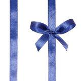 Blue ribbons with bow. Blue ribbons arranged obliquely with bow isolated on white background Royalty Free Stock Photography