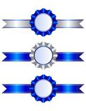 Blue ribbons and rosettes Stock Photos