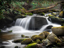 Blue Ridge Forest Waterfall With Milky Water. A small forest waterfall landscape with the milky water effect and lots of green moss and stones. Real deep woods Stock Photos
