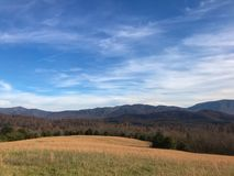 Blue Ridge Mountains in Autumn. The Blue Ridge mountains near Natural Bridge Virginia. A prairie with golden yellow grasses. Sky was partly cloudy, but overall a Stock Photos