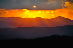 Blue Ridge Mountains Layered Sunset Rays. Raining down from the clouds above Royalty Free Stock Photo