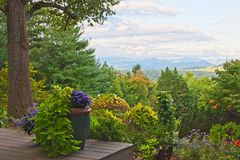Blue Ridge mountains seen from North Carolina back yard. A backyard deck in Asheville, North Carolina with the Blue Ridge mountains in the distance Stock Images