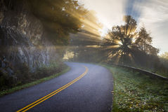 Blue Ridge Parkway North Carolina Sun Rays. Of Light beam through the trees along the road in the Appalachian Mountains in western NC Stock Photography
