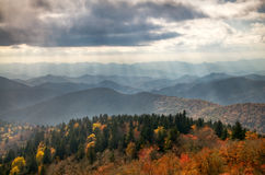 Blue Ridge Parkway Scenic Autumn Landscape. With sunbeams over mountains w/ fall foliage Stock Photo