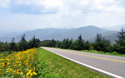Blue Ridge Parkway and Smoky Mountains. A stretch of road along the Blue Ridge Parkway in Western North Carolina, with the Smoky Mountains in the background royalty free stock image