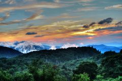 Smoky Mountain Sunrise. You can find so many vistas along the Blue Ridge Parkway. Here at mile marker 418 Graveyard Fields overlook faces east for an amazing Royalty Free Stock Photography