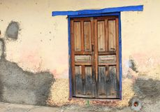 Blue-rimmed wooden door, Mexico Royalty Free Stock Photo