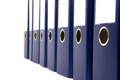 Blue ring binders. A row of blue ring binders with blank label isolated on white Royalty Free Stock Image