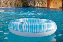 Blue Ring float in swimming pool Royalty Free Stock Image