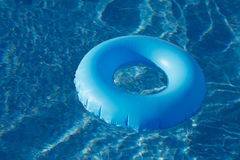 Blue ring floating on  crystal clear  water pool Stock Image
