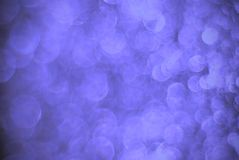 Blue rings and bubbles seamless texture. Defocused coloured lights abstract background Stock Image