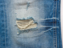 Blue ripped jeans Stock Photo