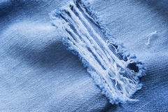 Blue ripped jeans Royalty Free Stock Image