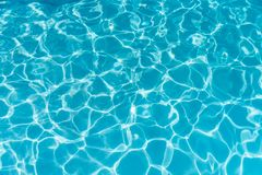 Free Blue Ripped Water In Swimming Pool. Water Surface Background. Stock Images - 136541984