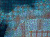 Blue ripped water in swimming pool with stair ceramic tile mosaic in background Stock Photography