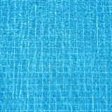 Blue rippled water background in swimming pool Royalty Free Stock Photo
