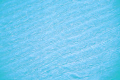 Blue ripples of water over sand Royalty Free Stock Photo