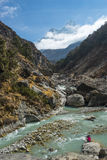 Blue river with Ama Dablam mountain background, Everest region, Stock Photo