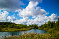 Blue river. On a background cloudy sky Royalty Free Stock Photography