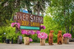 Entry sign to Blue River Safari Tours in canadian Rocky Mountains royalty free stock image