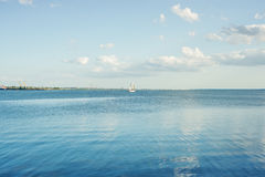Blue river and clouds with white yacht Stock Photo