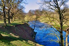 Blue river in countryside Stock Photo