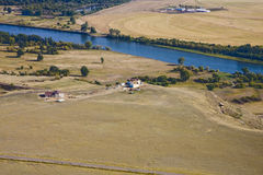 Blue River Through Farmland Royalty Free Stock Photo