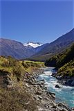A Blue River Flows Down the Valley Through New Zealand stock photos