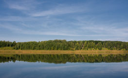 Blue river, forest reflected Stock Photography