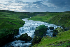 Blue river among green hills at the sunset South Iceland Stock Images