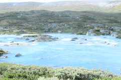Blue river in Jotunheimen national Park. royalty free stock photos