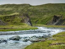 Blue river camong green hills in South Iceland stock photos