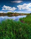 Blue river in summer cloudy day Royalty Free Stock Images