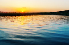 Blue river and sunset Royalty Free Stock Photography