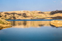 Blue river surrounded with several hills in Iraq Stock Photos