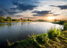 Blue river under clouds Royalty Free Stock Images