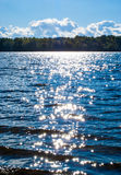 Blue river water surface with stars. Shining effect Royalty Free Stock Photo
