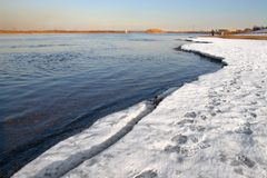 Blue river and white ice. Royalty Free Stock Images