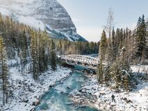Blue river in a winter mountains with a bridge