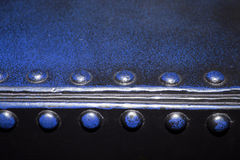 Blue rivetteed metal edge Stock Photos
