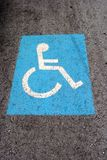 Blue road marking for disabled Royalty Free Stock Photo