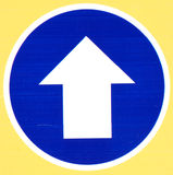 Blue Road Sign With Arrow Stock Images