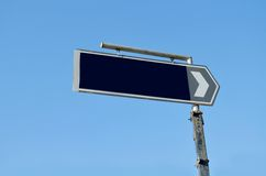 Blue road sign with arrow Royalty Free Stock Photo