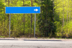 Blue road sign near highway with blank place Royalty Free Stock Photography