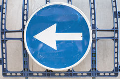 Blue road sign with white arrow Royalty Free Stock Photo