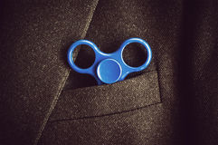 Blue road spinner in the hand Stock Photography